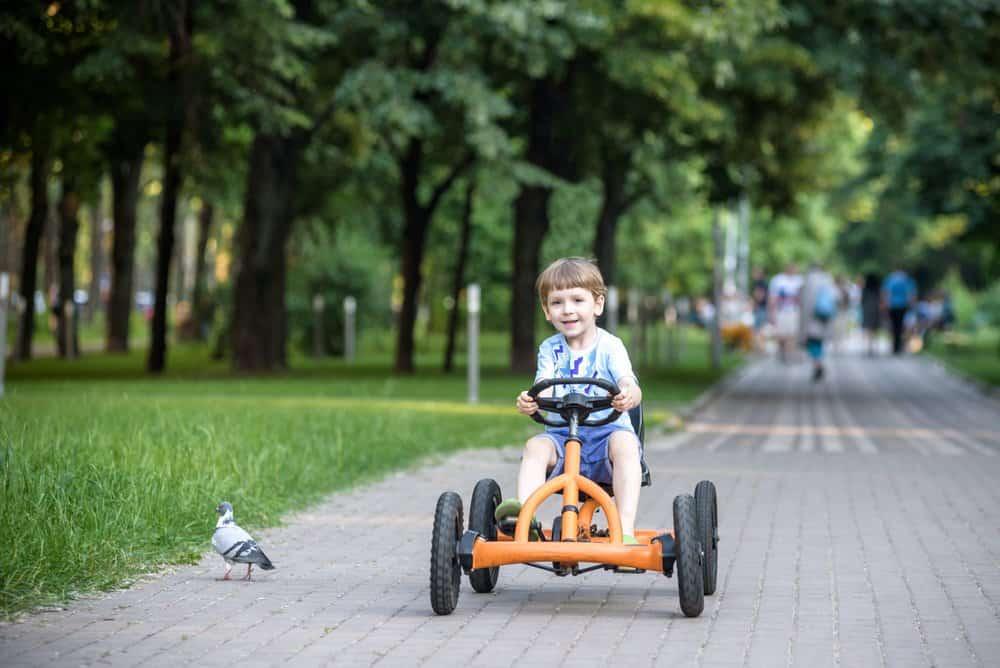 Young boy riding a go kart