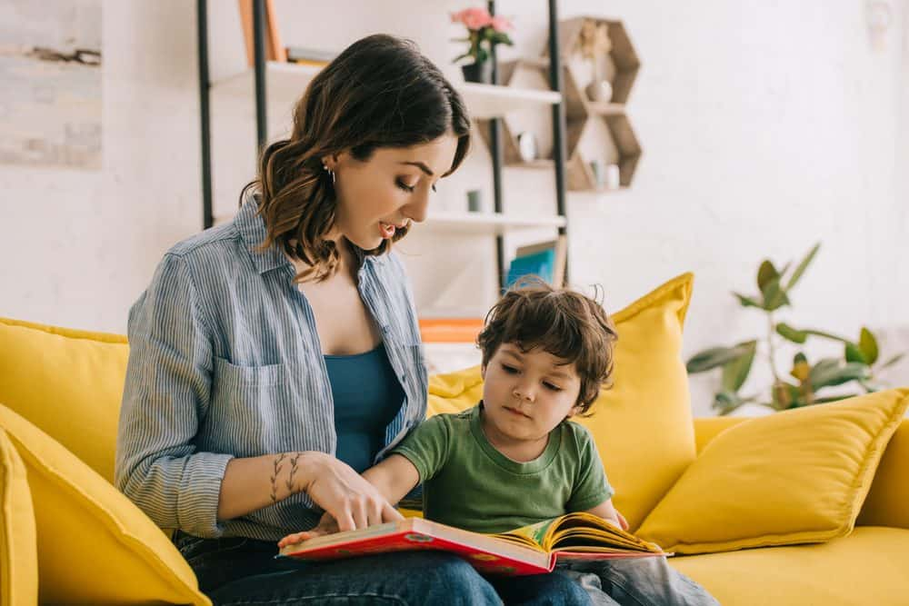 Mom reading to her toddler son