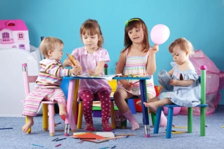 Toddlers and kids coloring at a table