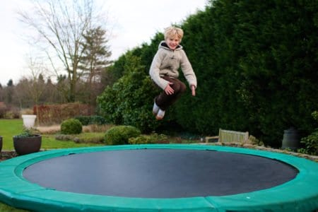 Young boy jumping on a trampoline