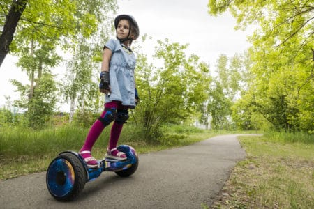 Little girl on a hoverboard