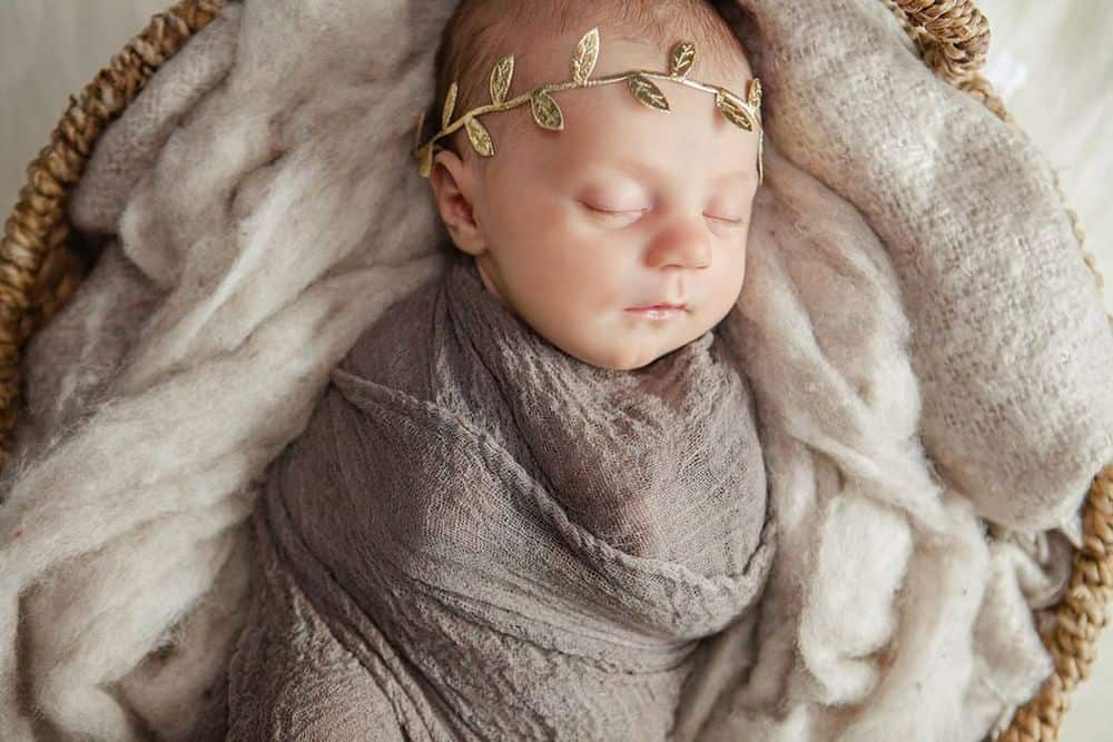 Newborn dressed as a greek goddess