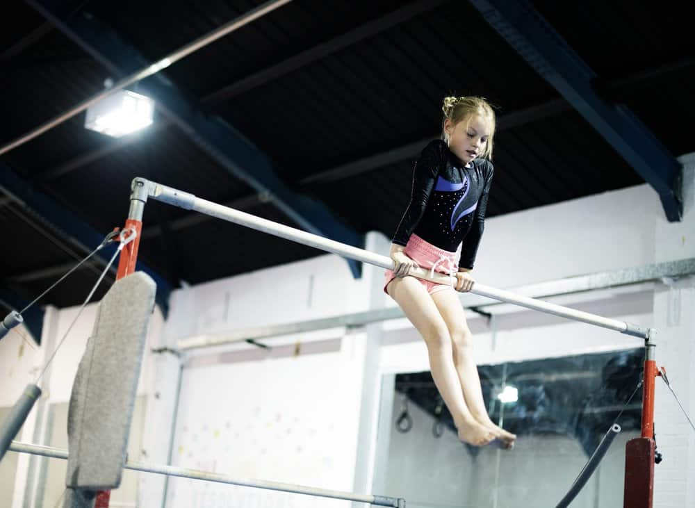 Young gymnast on a gymnastics horizontal bar