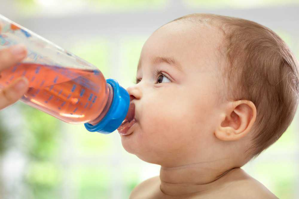 Baby drinking tea from bottle