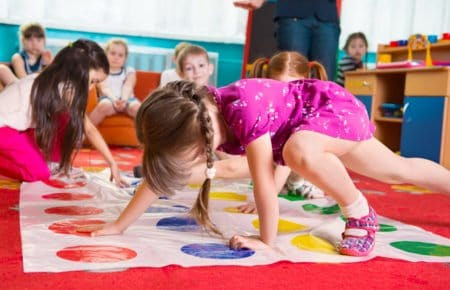 Preschoolers playing color twister for motor activities