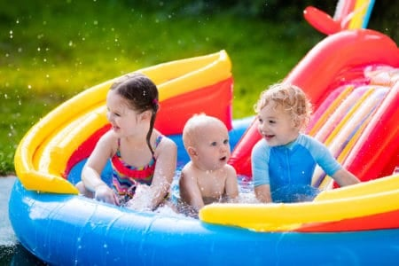 Kids playing in an inflatable water slide
