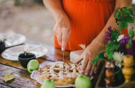 Pregnant woman preparing apple apple for a pregnancy announcement