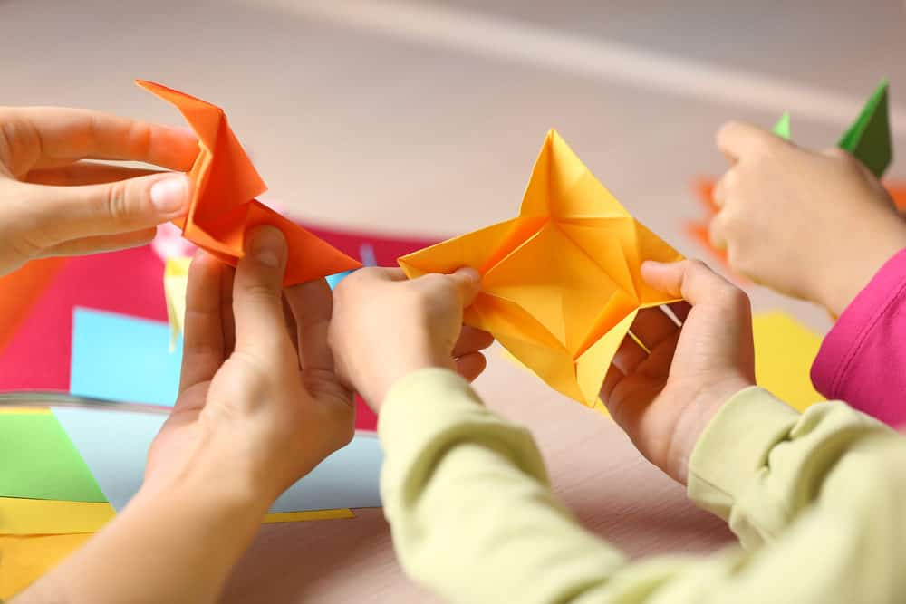 Kids making origami
