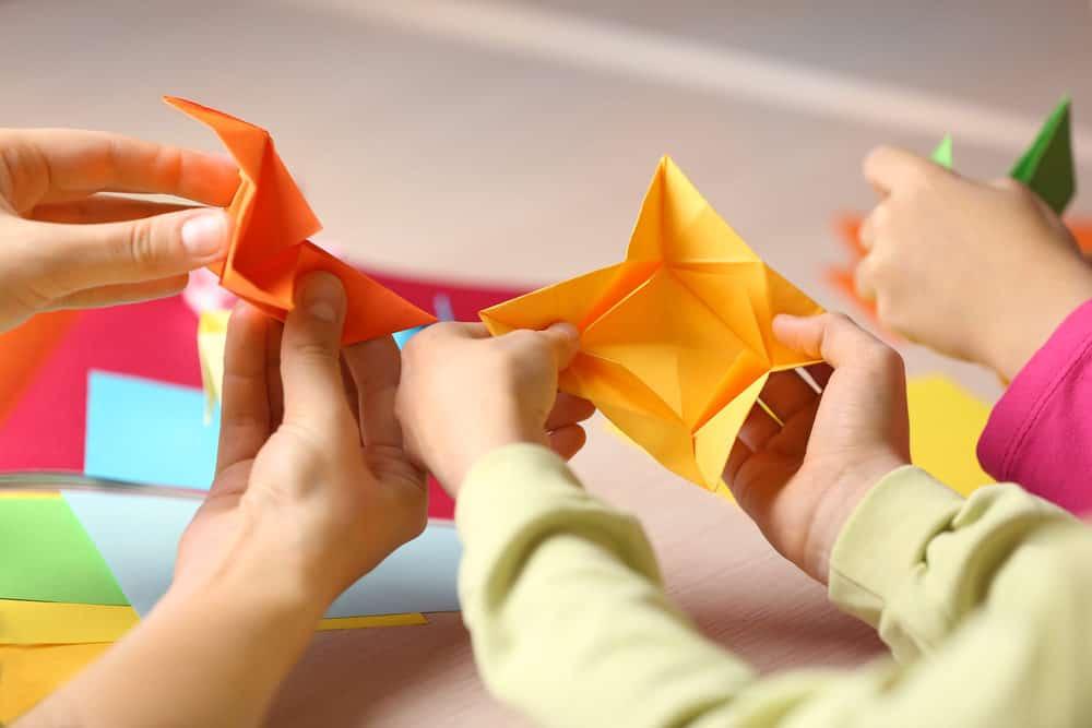 Kids making origami