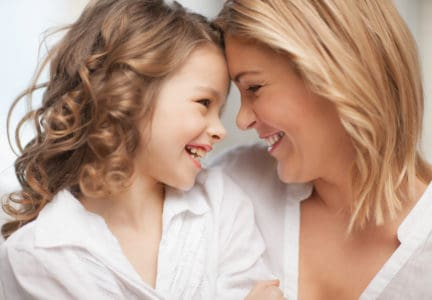 Smiling mother affirming daughter