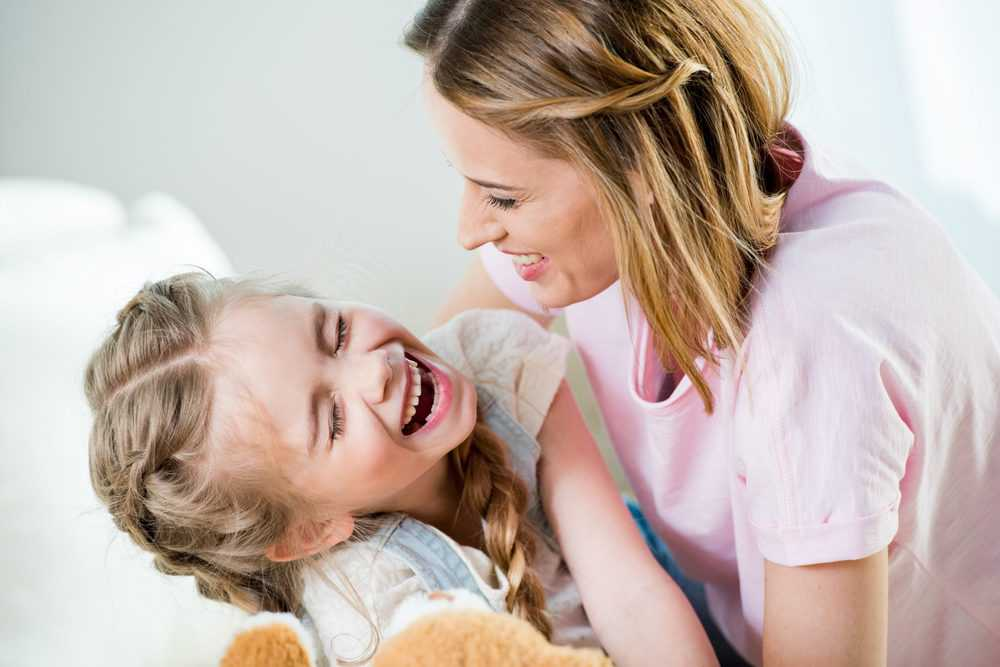 Mother and daughter laughing at a joke