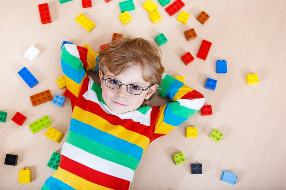 Little boy playing with colorful legos