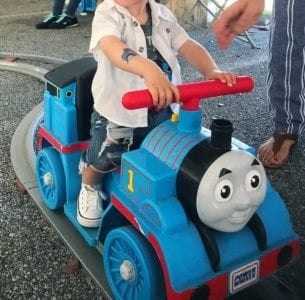 Cute toddler on a ride-on train
