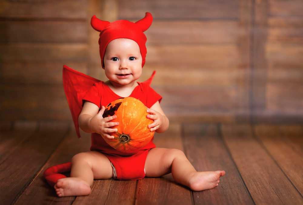 Cute baby in devil costume