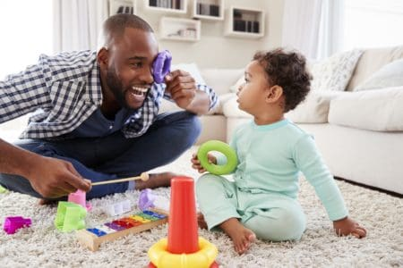 Dad playing toys with 7 month old baby