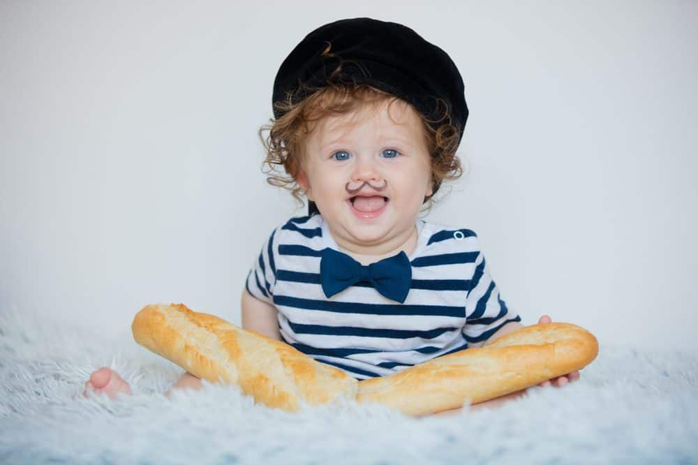 Cute little french boy with baguette
