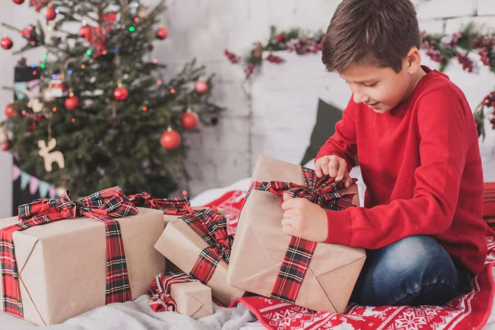 15 year old boy opening his christmas gifts