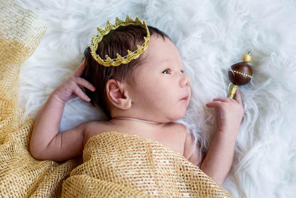 Newborn baby boy with a golden crown