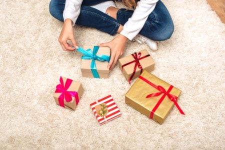 Teenager opening gifts