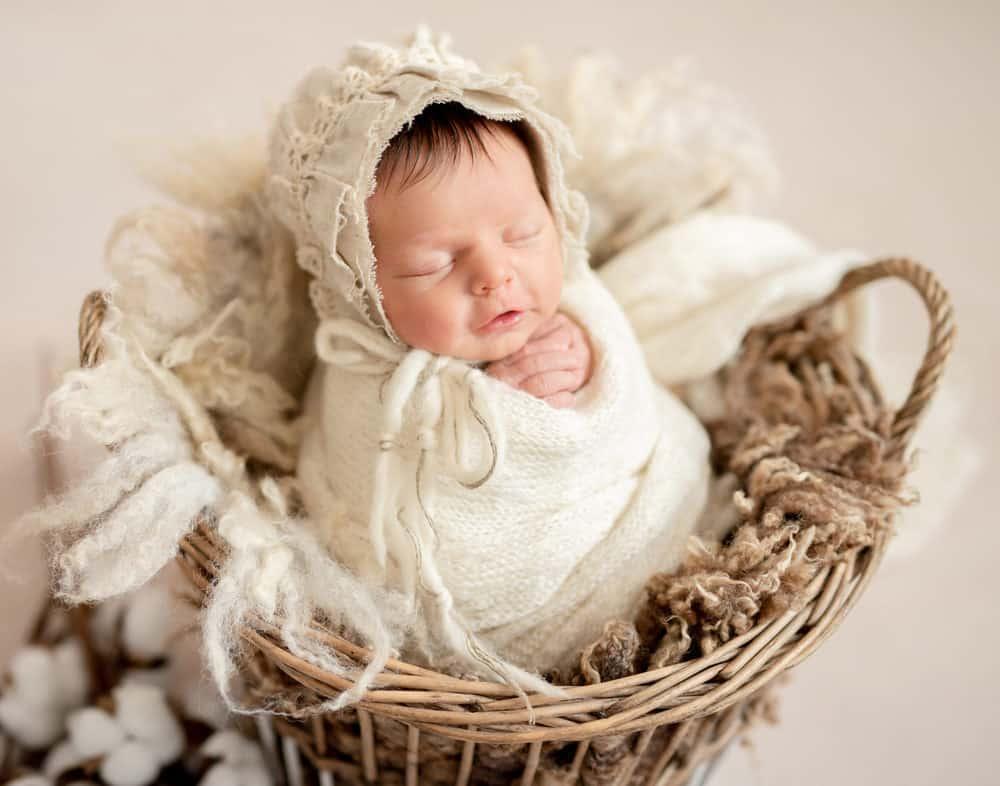 Cute sleeping newborn baby girl knitted bonnet
