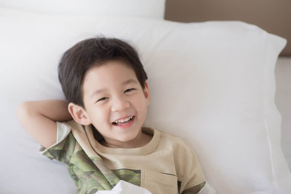 Cute Korean boy lying on the bed