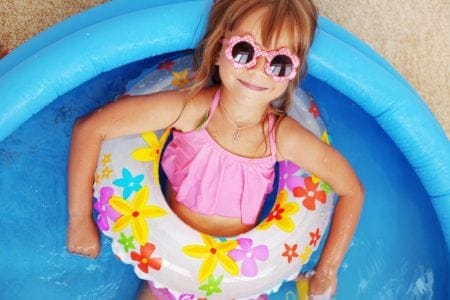 Little girl chilling in a kiddie pool
