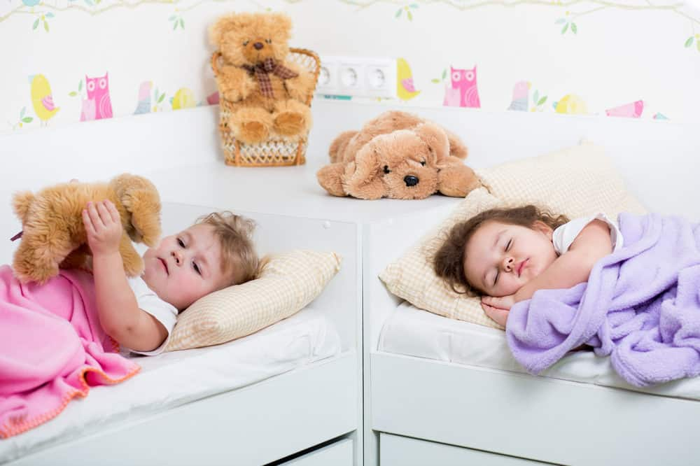 Little girls sleeping in their own beds