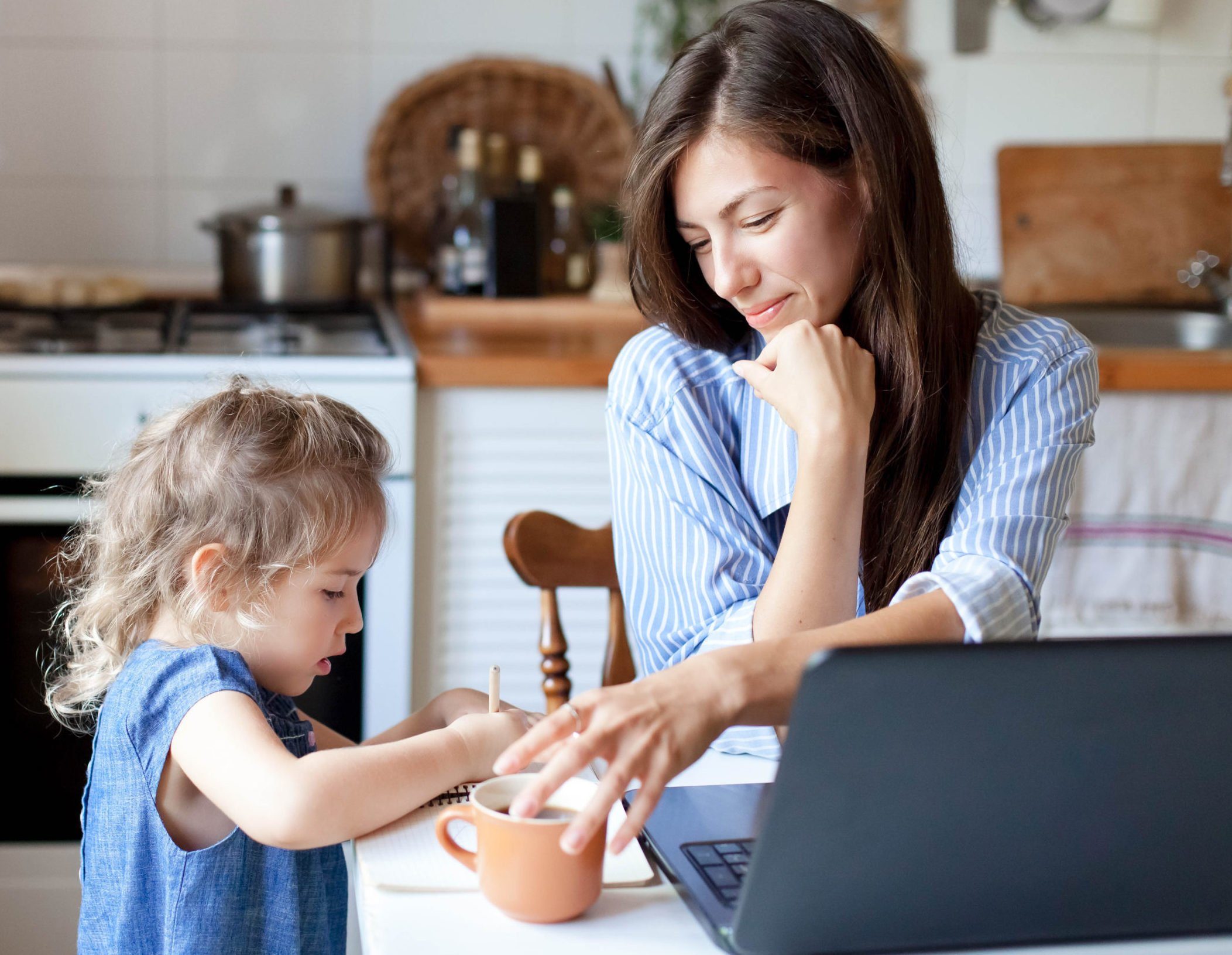 Mom working from home while playing with daughter