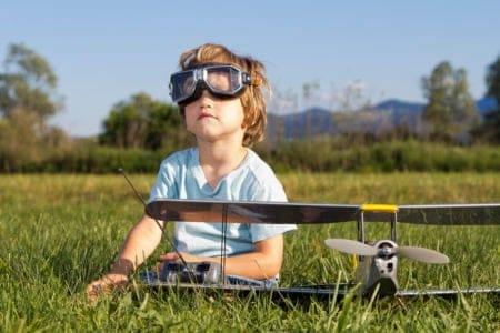 Little boy playing with rc plane