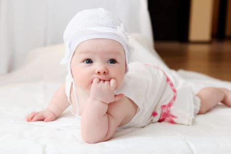 Cute little baby in a funny hat