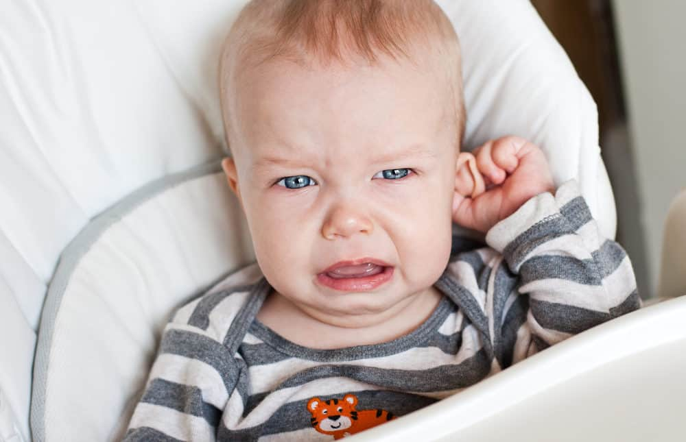 Cute little boy crying with ear infection