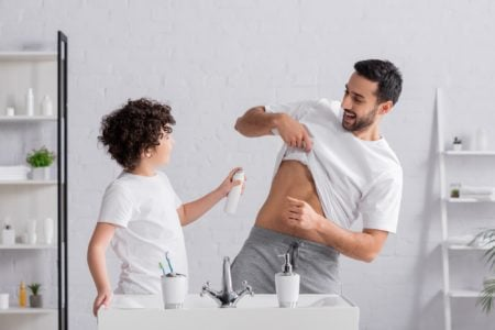 Boy spraying deodorant