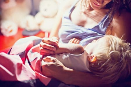 A woman breastfeeding her baby