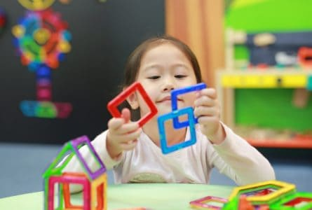 Little girl playing with magnetic toys