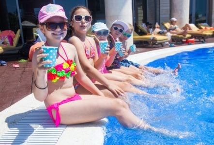 Children having fun on the side of the pool